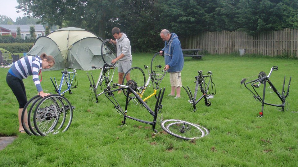 Paul and Clive do maintenance while Naomi counts the wheels