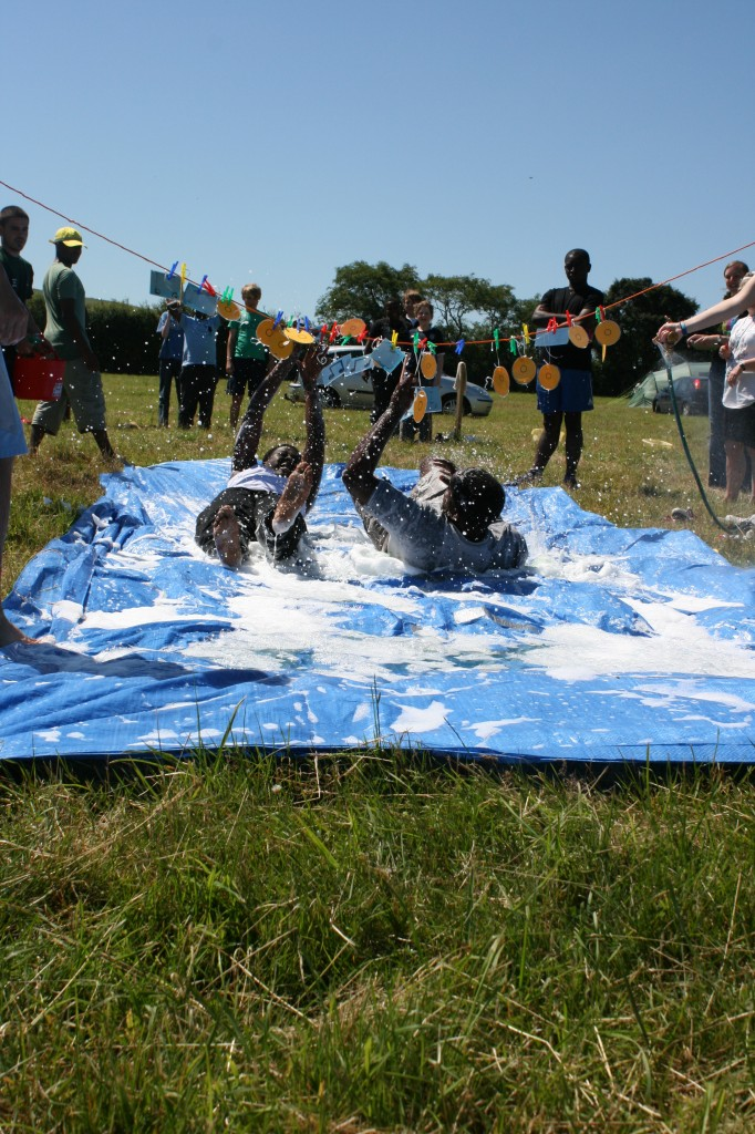 Young people water sliding